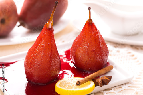 Two poached pears in red wine