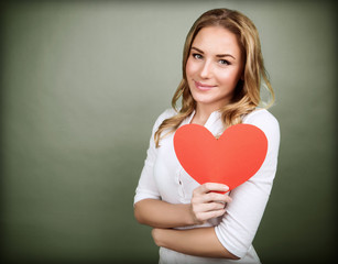 Cute girl with red paper heart