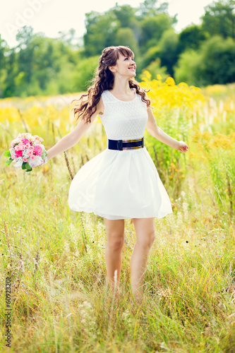 girl in white dress with a bouquet of flowers and swirls in a fi