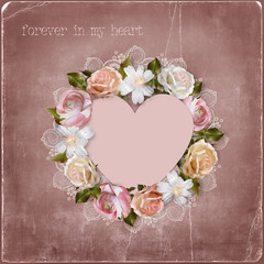 Wreath of flowers and heart on vintage background