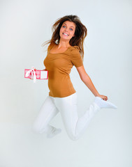 happy woman jumping with gift