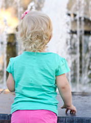 Back of Little Girl  looking to Fountain