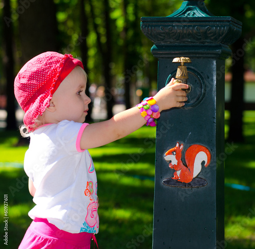 Smart Cute Girl near  the Tap, Park, Outdoor