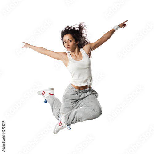 Jumping young female dancer,modern style dancer posing in studio