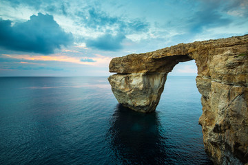 Azure Window, natural arch on Gozo island, with blue sky