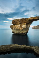 Azure Window, natural arch on Gozo island, with sky and clouds