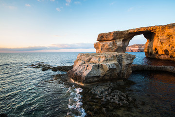 Azure Window, natural arch on Gozo island, at sunset