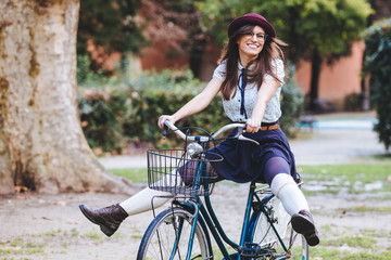 Old Fashioned Woman Riding Bicycle at Park