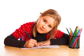 Cute little girl is writing