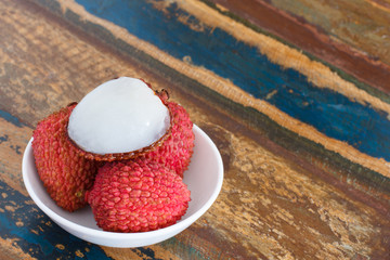Lychee on white plate on table
