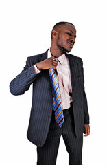 Black man taking off tie.