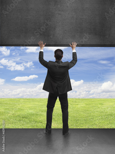 businessman holding wall
