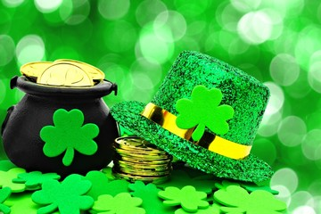 St Patricks Day Pot of Gold, hat and shamrocks over green