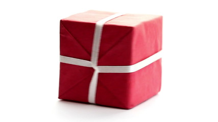 Gift box rotating, studio shot on white background