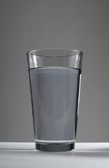 glass of water on background