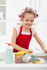 Little girl housekeeping - doing the dishes