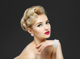 "Beautiful young girl with jewels. Makeup in sixties style ""arrow"