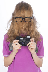 Young photographer with he face covered by hair