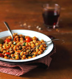 Cooked chickpea stew with roasted cherry tomatoes