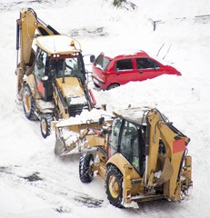 Excavators cleans snow blocked parking