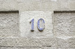 Number ten on a stone wall