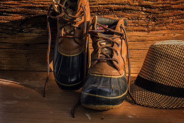 A pair of leather hiking boots on wooden floor