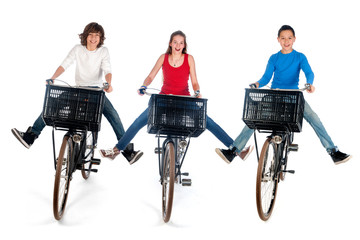 two boys and a girl on bike