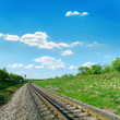 railroad in green landscape and blue sky