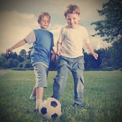 two happy boy play in soccer