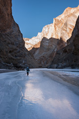 Winter trekking on the frozen Zanskar River in Ladakh.