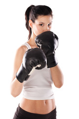 Cute female model wearing boxing gloves