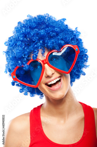 Funny female with blue wig and big glasses