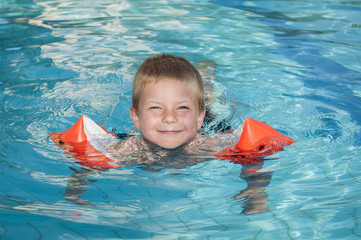 Smiling boy enjoying the swimming pool