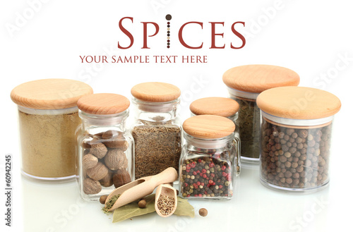In de dag Kruiden 2 jars and wooden spoons with spices isolated on white