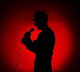 Musician silhouette on dark color background