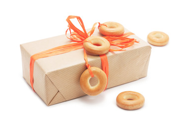 gift box with orange ribbon and bagel