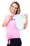 Young pregnant woman holding blue romper isolated on white