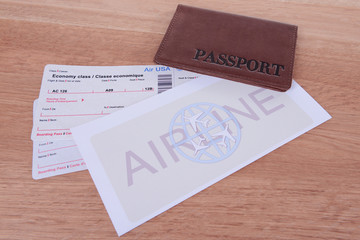 Airline tickets with passport on table close-up