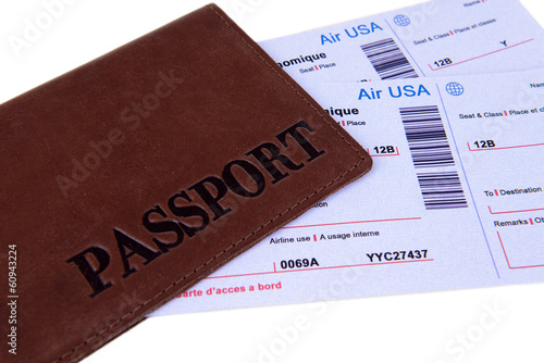 Airline tickets with passport close-up