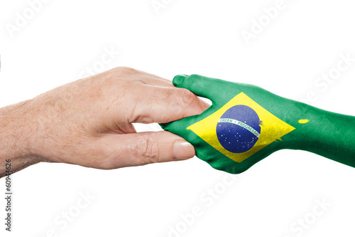 Two hands and Brazilian flag