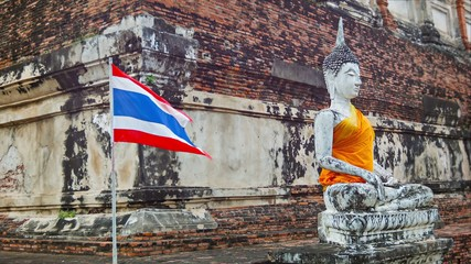 Buddha statue and Thai flag in the temple