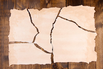 Pieces of torn color paper, on color wooden background