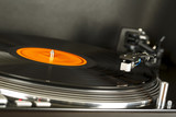 Turntable rotates together with vinyl record on