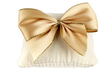 Soft pillow decorated with a bow