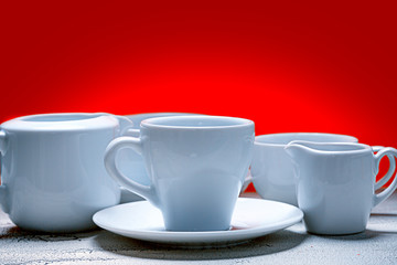 different white cups over red