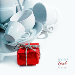 red gift box and clean dishes and cups