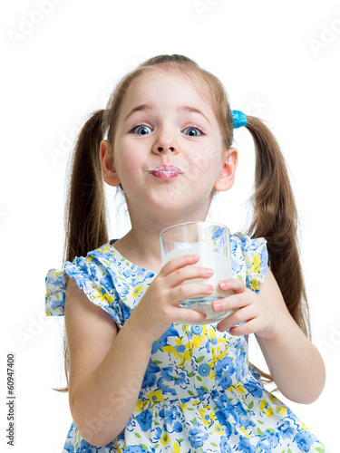 funny child girl drinking milk or kefir over white