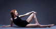 Seductive redhead slim model lying in studio