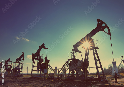 working oil pumps silhouette - vintage retro style - 60948673