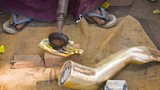 Polishing the parts for bronze statue. Myanmar, Mandalay, metal